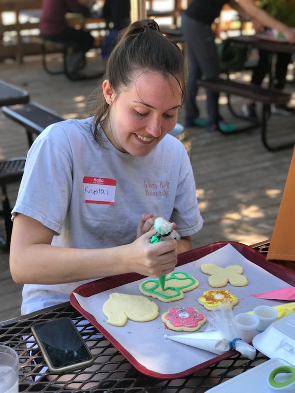 Holloman spouse decorates cookies, May 8-9, at Sacramento Camp and Conference Center, New Mexico.