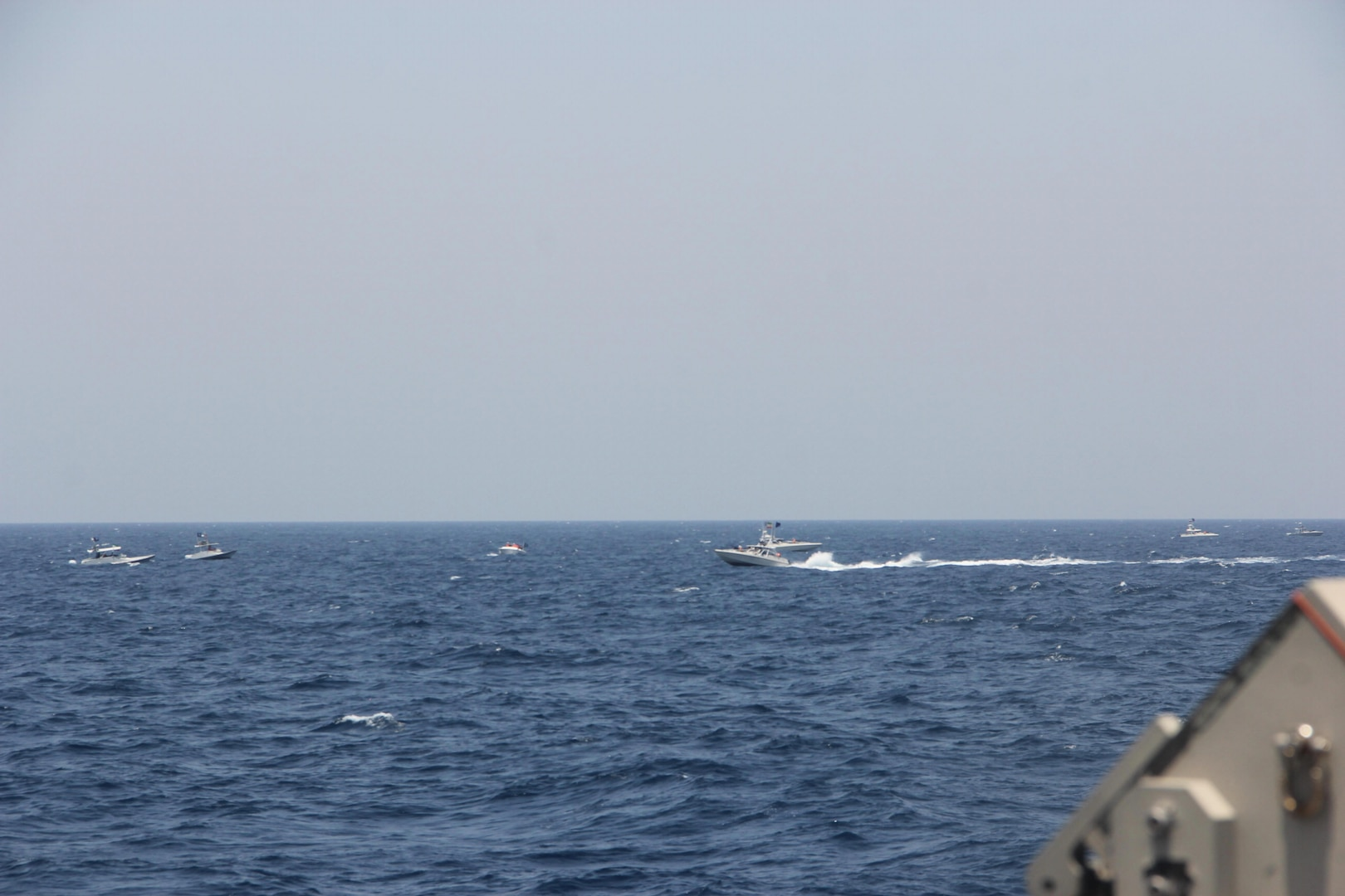 STRAIT OF HORMUZ (May 10, 2021) Two Iranian Islamic Revolutionary Guard Corps Navy (IRGCN) fast in-shore attack craft (FIAC), a type of speedboat armed with machine guns, conducted unsafe and unprofessional maneuvers while operating in close proximity to U.S. naval vessels transiting the Strait of Hormuz, May 10.  U.S. forces exercised lawful defensive measure after the IRGCN vessels ignored repeated verbal and acoustic warning and closed toward Maui at a high speed and close distance with weapons uncovered and manned. (U.S. Navy photo)