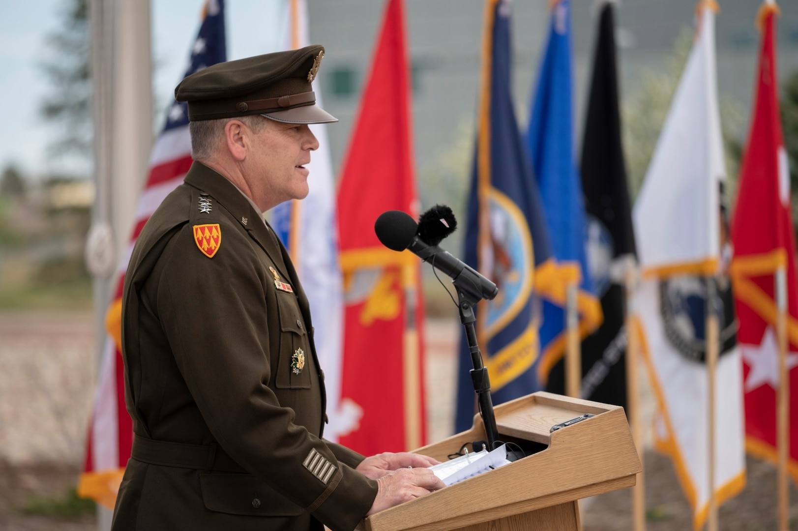 U.S. Army Gen. James Dickinson, commander of United States Space Command, addresses a crowd of service members and Gold Star families during USSPACECOM's Gold Star service flag raising ceremony May 7 at Peterson Air Force Base, Colorado. The ceremony was held in conjunction with Gold Star Awareness Month.