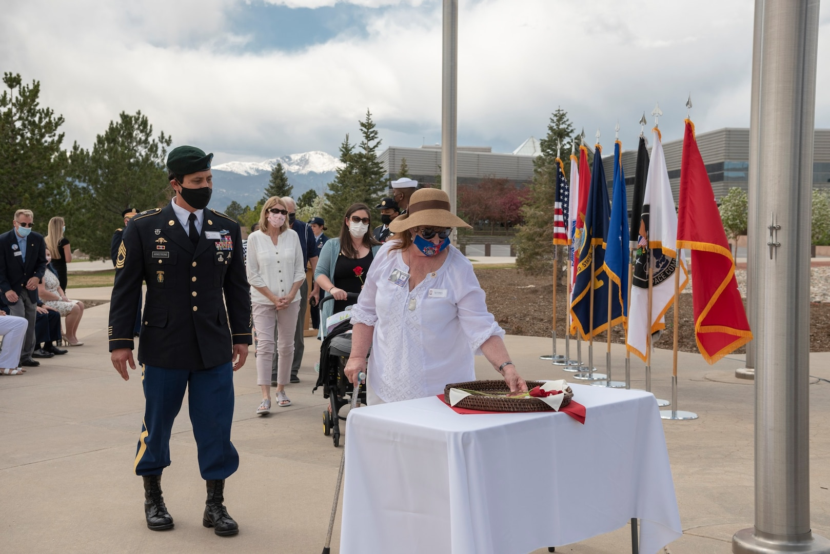 Gold Star families from Colorado's Front Range place remembrance roses at the base of the flagpole May 7 during a Gold Star flag raising ceremony at Peterson Air Force Base, Colorado. Each rose represented a fallen service member.