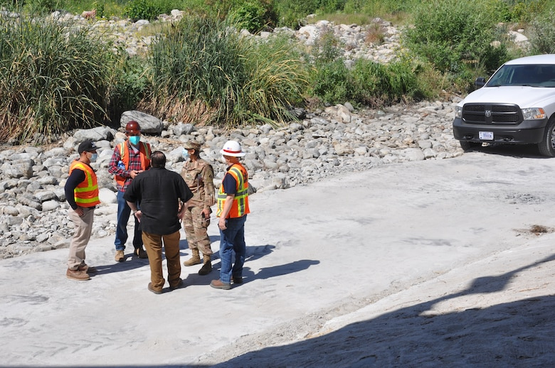 In the burgundy helmet, Contractor Jordan Soto of Rio Jordan Construction conducts an overview and safety briefing about the toe road maintenance project for Corps' District program manager Lt. Col. Malia Pearson and her team, May 4, on the toe road in the Los Angeles River.