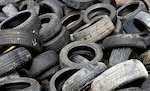 Tires lay in a pile at Ramstein Air Base, Germany. Air Force, Army Corps of Engineers and Defense Logistics Agency research and development scientists and engineers, along with property disposal specialists, are examining ways to reduce the military's waste stream by turning items like used tires into fuel, electricity, and recycled products.