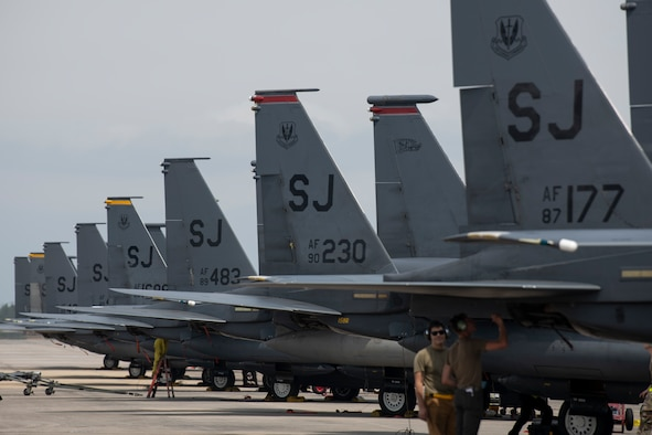 Several F-15E Strike Eagles, assigned to the 4th Fighter Wing, sit on the ramp for Agile Flag 21-2 at Tyndall Air Force Base, Fla., April 30, 2021. Air Combat Command developed the experiment to create a lead wing, aligning squadrons from different locations under a single commander, enhancing their readiness as a team before deploying into a contested environment.