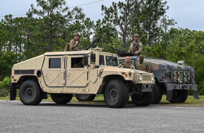 Members of the 822nd Base Defense Group, Moody Air Force Base, Ga., perform a shift change during exercise Agile Flag 21-2 at Naval Outlying Landing Field Choctaw, Fla., May 3, 2021. The primary mission of the 822nd BDS is training to deploy to different theaters.