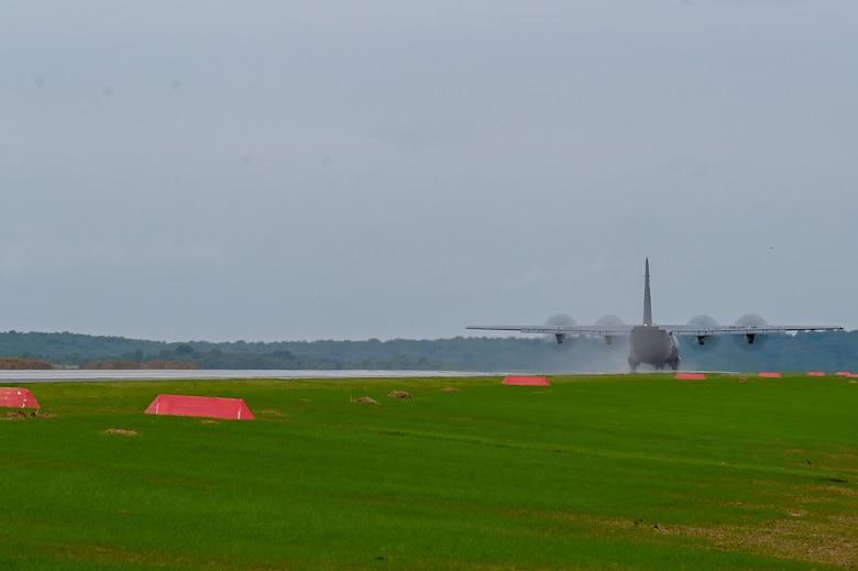 A C-130J lands on an assault landing zone