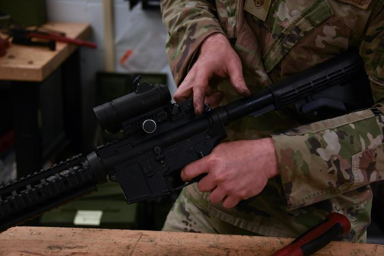 airman fixes rifle