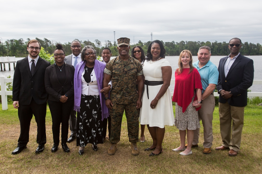 U.S. Marine Corps Brig. Gen. Select Anthony Henderson (Center), the oncoming commander of 2nd Marine Expeditionary Brigade (MEB), II Marine Expeditionary Force, poses for a group photo with his family and friends after a change of command ceremony on Marine Corps Base Camp Lejeune, May 11, 2021. Brig. Gen. Select Henderson took command over 2nd MEB from the previous commander, Col. David Everly. (U.S. Marine Corps photo by Sgt. Jesus Sepulveda Torres)