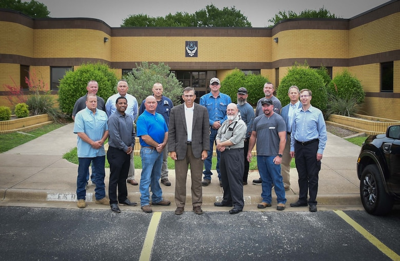 301st Fighter Wing Base Civil Engineers stand in front of the wing's civil engineer squadron building at U.S. Naval Air Station Joint Reserve Base Fort Worth, Texas on March 10, 2021. BCE consists of 17 people from across two sections—engineering and operations. They currently support the installation, the 301 FW's F-16 Fighting Falcon mission and are preparing for the wing's new mission as the Air Force Reserve Command's first F-35A Lightning II unit. (U.S. Air Force photo by Senior Airman William Downs)