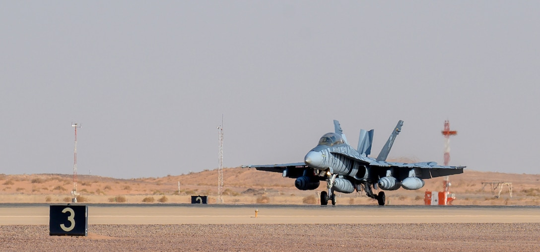 A U.S. Marine Corps F/A-18D Hornet lands on the flightline at Prince Sultan Air Base, Kingdom of Saudi Arabia, May 8, 2021. Personnel, aircraft, and supplies from Marine All Weather Fighter Attack Squadron 224, Marine Aircraft Group 31, deployed to PSAB from Marine Corps Air Station Beaufort, South Carolina, as part of a dynamic force employment to enhance U.S. Central Command's ability to deter aggression and promote security and stability within the USCENTCOM area of responsibility. (U.S. Air Force photo by Senior Airman Samuel Earick)