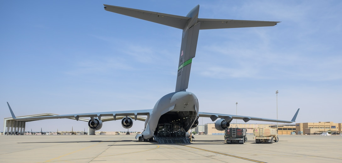 Personnel from the 378th Expeditionary Logistics Readiness Squadron refuel a U.S. Air Force C-17 carrying cargo from Marine Corps Air Station Beaufort, South Carolina, after it landed at Prince Sultan Air Base, Kingdom of Saudi Arabia, May 5, 2021. Personnel, aircraft, and supplies from Marine All Weather Fighter Attack Squadron 224, Marine Aircraft Group 31, deployed as part of a dynamic force employment to PSAB to enhance U.S. Central Command's ability to deter aggression and promote security and stability within the USCENTCOM area of responsibility. (U.S. Air Force photo by Senior Airman Samuel Earick)