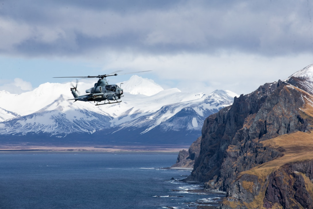 210503-M-JX780-1330 GULF OF ALASKA (May 3, 2021) – A U.S. Marine Corps AH-1Z Viper assigned to Marine Medium Tiltrotor Squadron 164 (Reinforced), 15th Marine Expeditionary Unit flies over the Gulf of Alaska in support of Northern Edge 2021. U.S. service members are participating in a joint training exercise hosted by U.S. Pacific Air Forces May 3-14, 2021, on and above the Joint Pacific Alaska Range Complex, the Gulf of Alaska, and temporary maritime activities area. NE21 is one in a series of U.S. Indo-Pacific Command exercises designed to sharpen the joint forces' skills; to practice tactics, techniques, and procedures; to improve command, control and communication relationships; and to develop cooperative plans and programs. (U.S. Marine Corps photo by Lance Cpl. Brendan Mullin)