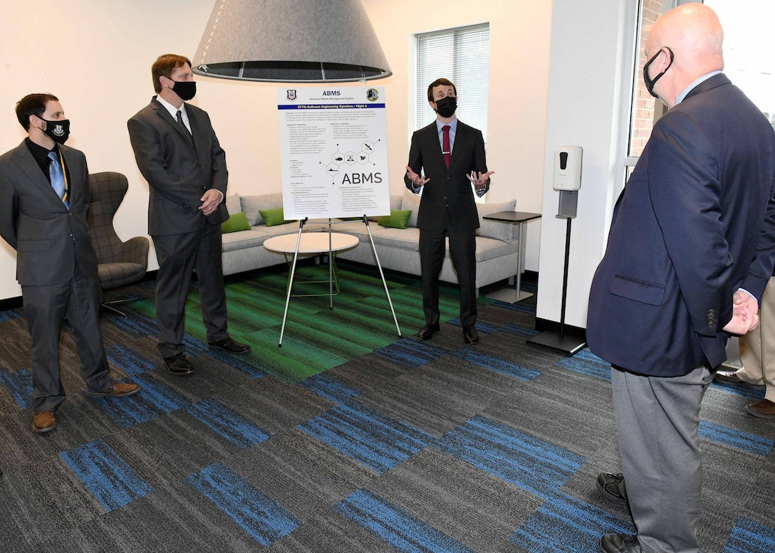 Acting Secretary of the Air Force John Roth is briefed by Derek Cook, 577th Software Engineering Squadron team lead, at the Project Synergy facility in Warner Robins, Ga., May 10, 2021. Project Synergy, a collaborative effort between the Warner Robins Air Logistics Complex and the Houston County Board of Education, was established in response to the growing software workloads within the Air Force and the need for space currently unavailable at Robins Air Force Base.