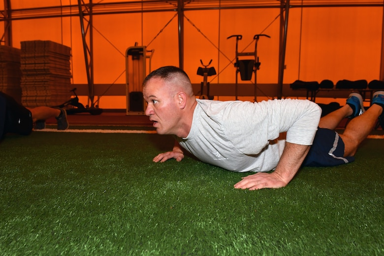 Member completes extended push up