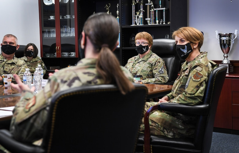 Air Force Surgeon General Lt. Gen. Dorothy Hogg, center, and Chief Master Sgt. Dawn Kolczynski, right, chief of the Medical Enlisted Force, listen to a mission brief by Chief Master Sgt. Holly Burke, 66th Medical Squadron superintendent, during a visit to Hanscom Air Force Base, Mass., May 11. During their visit, Hogg and Kolczynski met with members of the Hanscom clinic and recognized the positive impacts they have made through the pandemic. (U.S. Air Force photo by Lauren Russell)