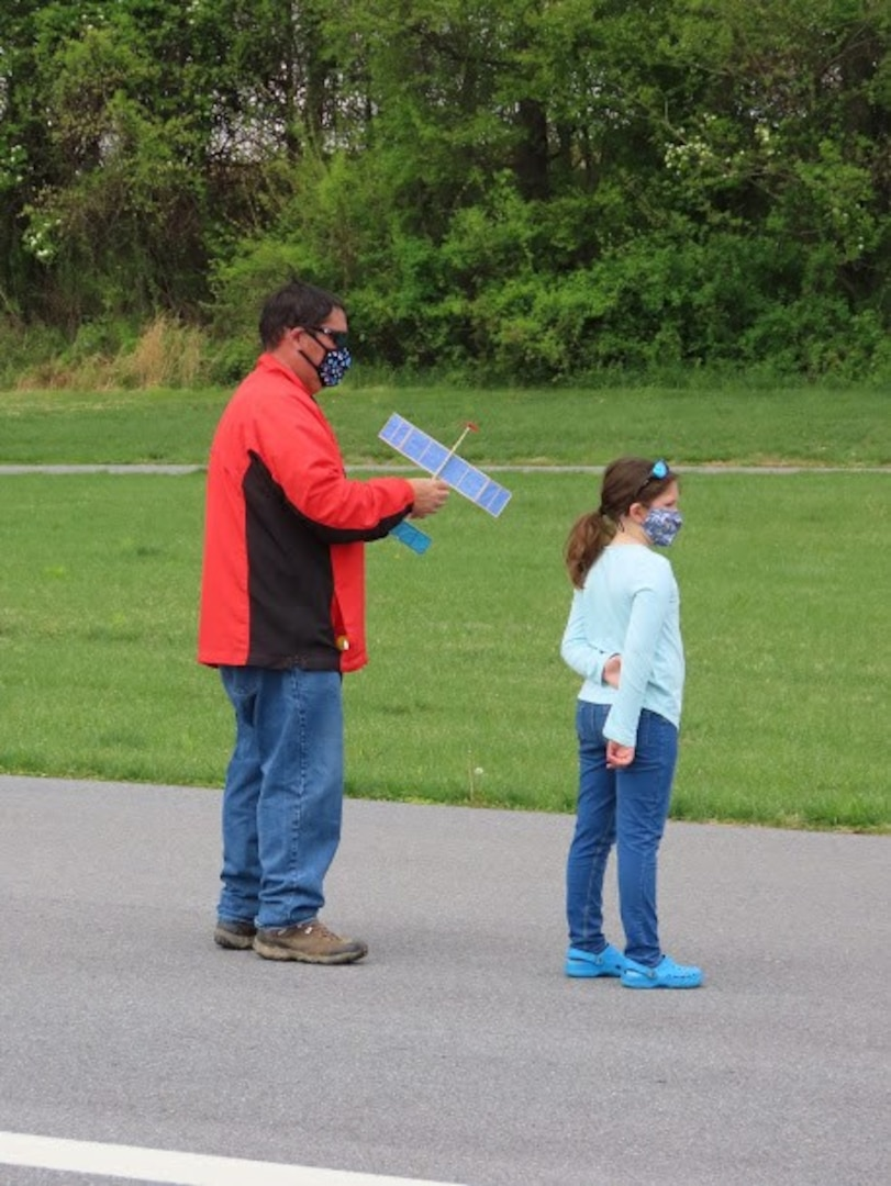 Earle B. Wood Middle School technology teacher John Lee and his daughter prepare to fly a rubber-powered, free-flight airplane at Davis Airfield in Laytonsville, Md., on April 25, 2021.