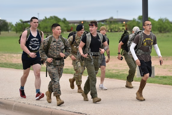 Goodfellow members jog during a ruck around Goodfellow Air Force Base, Texas, in honor of National Police Week, May 10, 2021. The ruck was approximately four miles and followed the perimeter of the base. (U.S. Air Force photo by Staff Sgt. Seraiah Wolf)