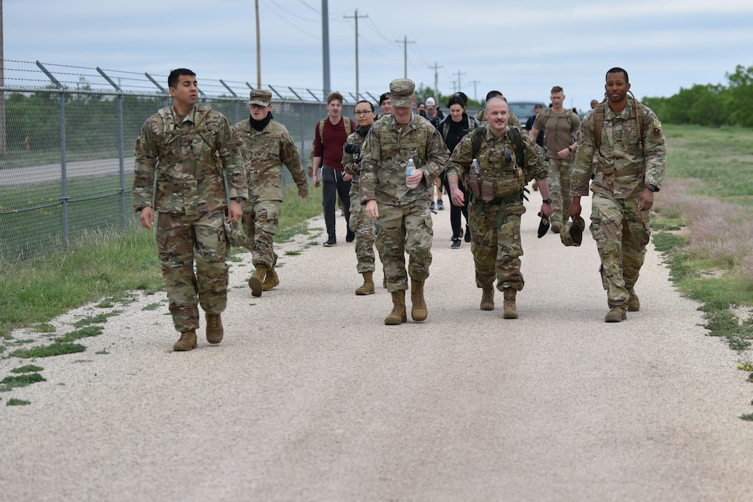 Goodfellow members finish the last portion of a ruck during National Police Week on Goodfellow Air Force Base, Texas, May 10, 2021. After the ruck a pancake breakfast was held for all of the participants. (U.S. Air Force photo by Staff Sgt. Seraiah Wolf)