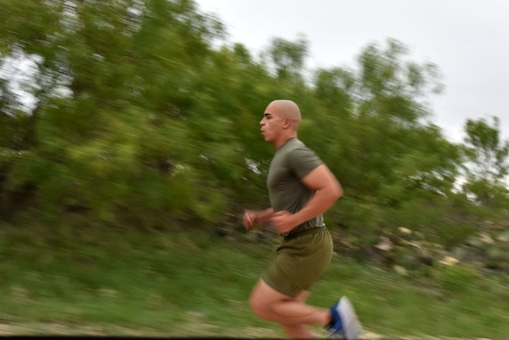 A Goodfellow member runs to the next challenge during the run and obstacle course on Goodfellow Air Force Base, Texas, May 12, 2021. The event was held in honor of National Police Week where members could walk, jog or run from one challenge to the next. (U.S. Air Force photo by Staff Sgt. Seraiah Wolf)