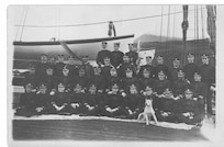 A photo of officers and mascots aboard Revenue Cutter Perry