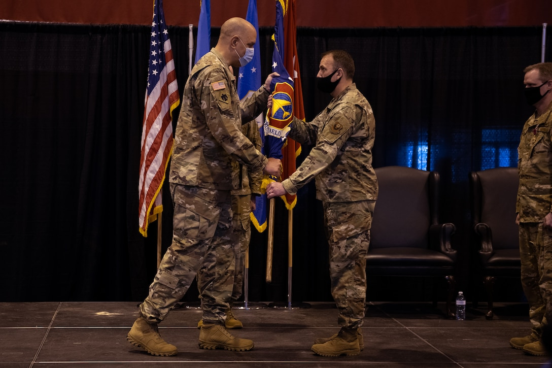 Col. Christopher D. Gries assumes command of the 137th Special Operations Wing from Maj. Gen. Michael Thompson, adjutant general for Oklahoma, at a change of command ceremony at Will Rogers Air National Guard Base (WRANGB) in Oklahoma City, May 1, 2021. Gries was formerly the 137th Operations Group commander and became the 18th wing commander at WRANGB. (U.S. Air National Guard photo by Senior Master Sgt. Andrew M. LaMoreaux)