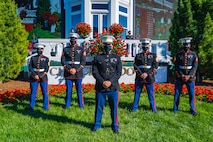 """Marines with Recruiting Station Louisville, stand in formation in the Winner's Circle at the Kentucky Derby in Louisville, Ky, May 1, 2021. The """"Winner's Circle,"""" is a horseshoe shaped enclosure at a Churchill Downs where the winning horse and jockey are brought to receive their awards. (U.S. Marine Corps photo by Cpl. Leo Amaro)"""