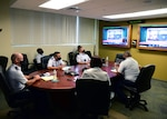 U.S. Air Force Col. Michael Foutch, left, Pacific Air Forces (PACAF) deputy command surgeon, and members of the PACAF Surgeon General's Office attend a virtual knowledge exchange with the Vietnam Military Medical University (VMMU), May 5, 2021. The engagement allowed medical experts from the USAF and the VMMU to share ideas and discuss training and education opportunities between the two parties.