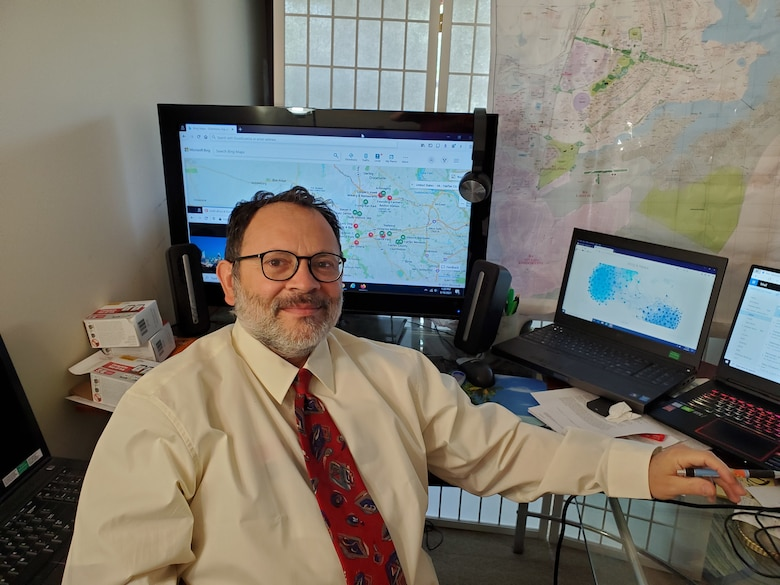 """Ray Dos Santos, a mathematician and computer scientist with the U.S. Army Engineer Research and Development Center's Geospatial Research Laboratory, Alexandria, Virginia, uses large amounts of historical data, social media activity and news articles to identify the best indicators of when and where a terrorist attack may take place. This """"Big Data"""" approach uses massive amounts of available information, along with high-end parallel computing, to find important clues in the fight against rogue activities. (U.S. Army Corps of Engineers photo)"""