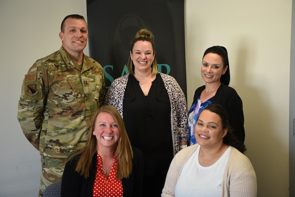 Wright-Patterson Air Force Base Sexual Assault Prevention and Response team members Capt. William Bolton (left), April Barrows, Annamae Willis, Kelly Hebert and Jazmyn Turner pose for a photo in their office May 12. The team won the 2021 Department of the Air Force Exceptional SAPR Team award for their effective and dedicated care for Wright-Patt Airmen. (U.S. Air Force photo by Airman 1st Class Jack Gardner)
