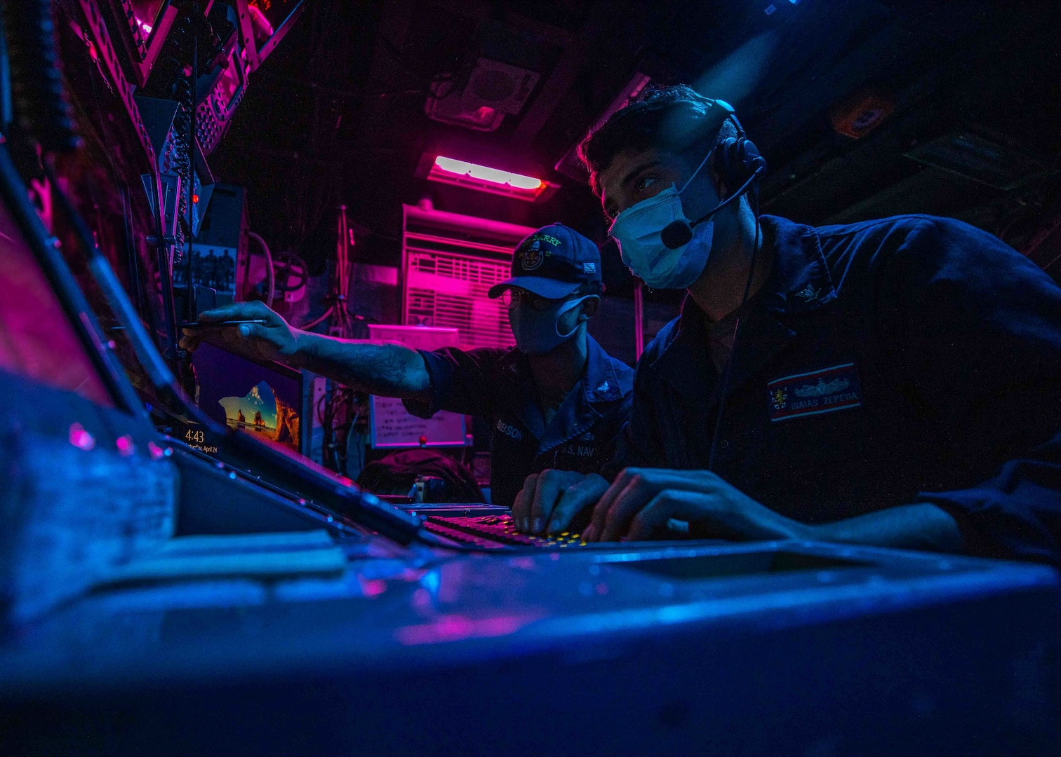 Cryptologic Technical Technician 2nd Class Brandon Gibson, from Sacramento, Calif. and Cryptologic Technical Technician 3rd Class Isais Zepeda, from Anthony, N.M., stand the Electronic Warfare Supervisor watch.