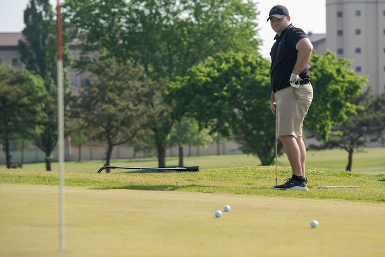 Airman from Osan Air Base participated in a golf tournament as part of the 51st Security Forces Squadron's Police Week events. Teams of up to four participants competed across 18 holes for a chance to win various prizes.