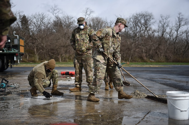 U.S. Air Force Airmen assigned to the 35th Fighter Wing learn to lay cement during Agile Combat Employment training at Misawa Air Base, Japan, April 9, 2021.