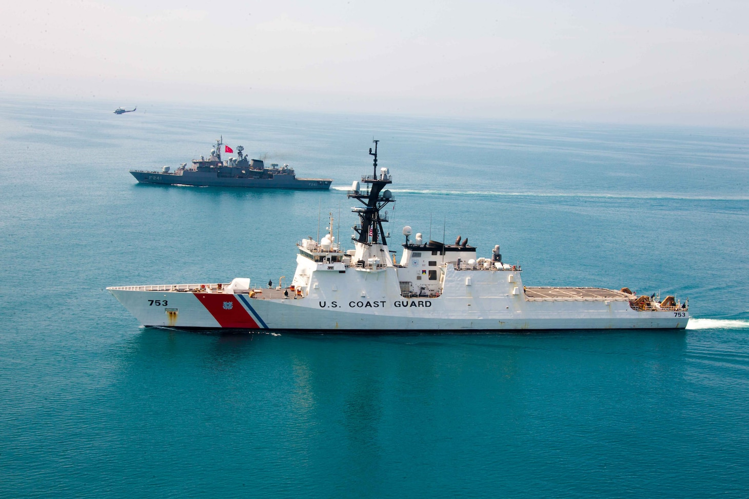 210430-G-G0108-1187 BLACK SEA April 30, 2021 U.S. Coast Guard members conduct boat and flight procedures on the USCGC Hamilton (WMSL 753) with Turkish naval members aboard the TCG Turgutries (F-241) in the Black Sea, April 30, 2021. Hamilton is on a routine deployment in the U.S. Sixth Fleet area of operations in support of U.S. national interests and security in Europe and Africa. (U.S. Coast Guard courtesy photo)