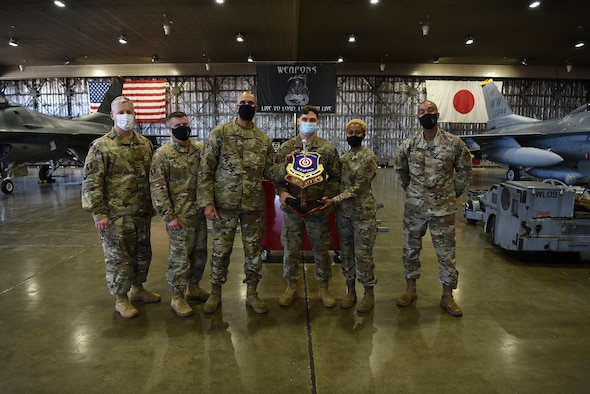 U.S. Air Force Airmen with the 13th Aircraft Maintenance Unit receive a trophy after winning the first quarter load competition at Misawa Air Base, Japan, April 23, 2021.