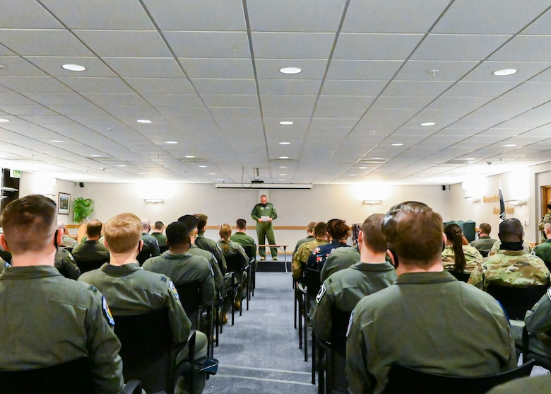 Lt. Col. Ryan Ferdinandsen, 351st Air Refueling Squadron commander, congratulates the squadron on their win of the 2020 Gen. Carl A. Spaatz Trophy for best performing air refueling squadron in the U.S. Air Force during a commander's call at Royal Air Force Mildenhall, May 11, 2021. Since the award's inception, the award has only been won by an overseas squadron twice; the 351st ARS made history in 2014 as the first overseas unit to be named the most outstanding air refueling squadron in the Air Force. (U.S. Air Force photo by Staff Sgt. Malissa Lott)