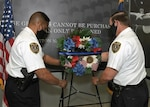 Yesterday, in honor of National Police week and in remembrance of fallen law enforcement officers, DIA Police Chief Andre Tibbs (left) and Deputy Chief John Richter (right) place a wreath at DIA Headquarters. (Photo by Dave Richards, OCC)