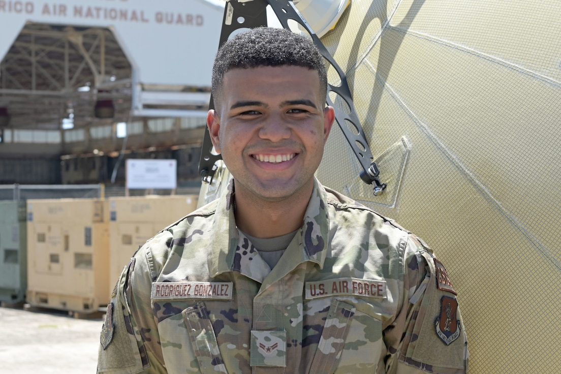 U.S. Airman 1st Class Tyron Rodriguez, transmission systems specialist, 156th Combat Communications Squadron, poses for a picture at Muñiz Air National Guard Base, Carolina Puerto Rico, May 5, 2021. (U.S. National Guard photo by Staff Sgt. Eliezer Soto)