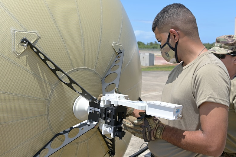 U.S. Airman 1st Class Tyron Rodriguez, transmission systems specialist, 156th Combat Communications Squadron, arranges a Ground Antenna Transmit and Receive (GATR) for small satellite combat communications to enhance mission capability at Muñiz Air National Guard Base, Carolina Puerto Rico, May 5, 2021. (U.S. National Guard photo by Staff Sgt. Eliezer Soto)