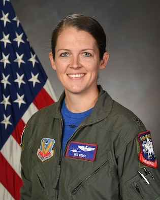A biographical headshot of Maj. Kristin Wolfe, Air Force pilot