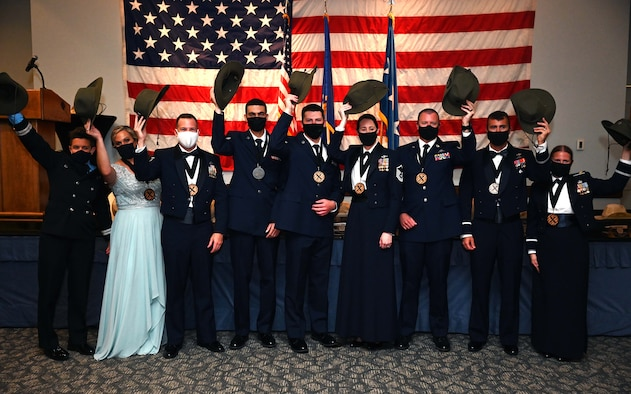 Air Force Special Operations Command's 2020 Outstanding Airman of the Year pose for a photo at the conclusion of the AFSOC OAY banquet at Hurlburt Field, Florida, May 13, 2021. AFSOC formally recognized the 2020 OAY winners with a base tour, a medallion breakfast and the formal banquet. (U.S. Air Force photo by Senior Airman Brandon Esau)