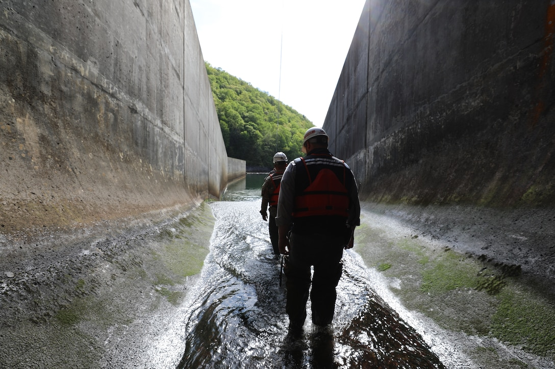 Anthony Lockidge, supervisory facility operations specialist and Dam operator for USACE Norfolk District exits the Gatheright Dam outlet tunnel during May 11 during the semi-annual dam inspection. The dam continues to perform as intended with the staff taking great care to maintain and operate safely. (U.S. Army photo/Breeana Harris)