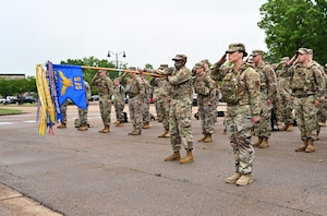 Squadrons from around the base salute the flag as reveille begins May 10, 2021, on Columbus Air Force Base, Mississippi. Reveille is a ceremony to signal the start of the duty day and shows respect to the flag along with Retreat used to signal the end of the duty day. (U.S. Air Force photo by Senior Airman Jake Jacobsen)