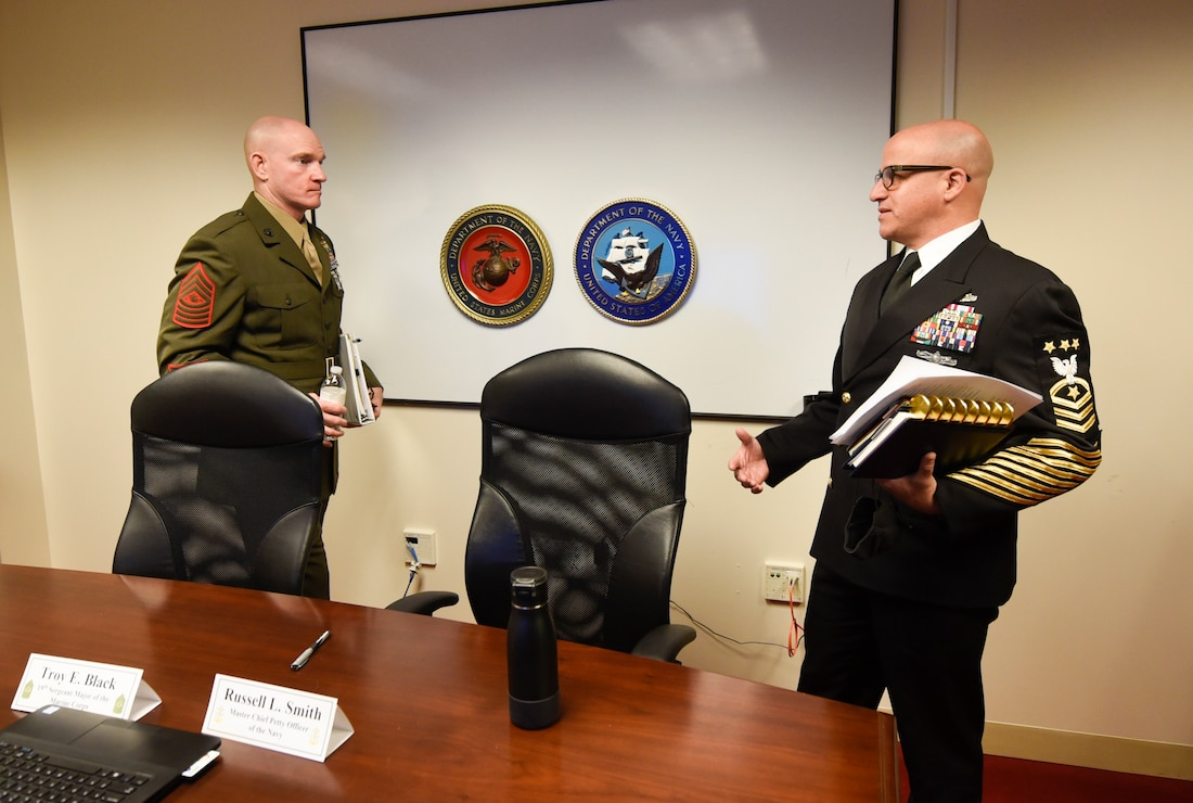 Sergeant Major of the Marine Corps Troy Black speaks with Master Chief Petty Officer of the Navy Russell Smith.