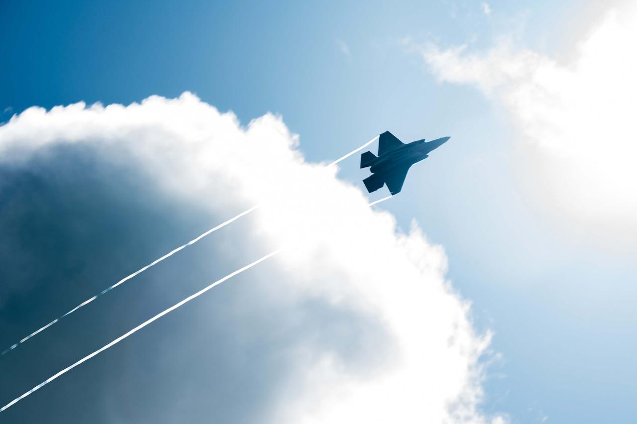 A jet streaks through the air.