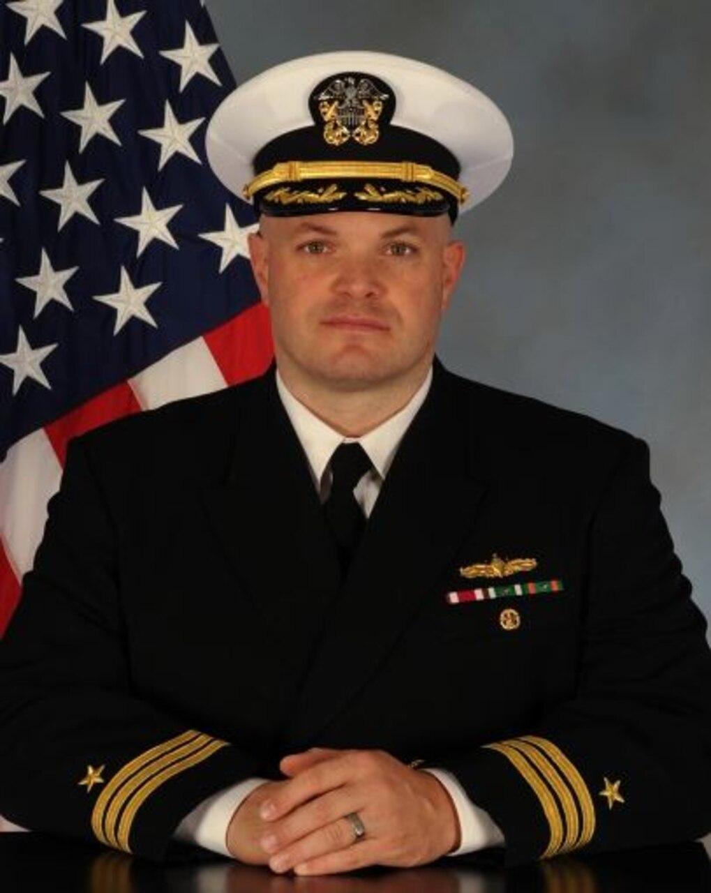 Commander Joshua D. Kristenson