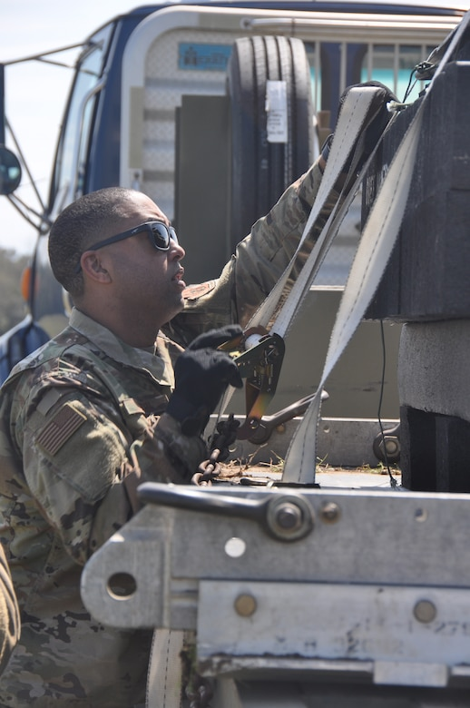 a man securing cargo on a truck