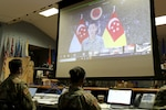 Brig. Gen. Lee Yi-Jin, Commander of the 6th Division, Singapore Armed Forces, virtually delivers remarks during the Exercise Tiger Balm 2021 opening ceremony at the 298th Regiment, Regional Training Institute (RTI), Waimanalo, Hawaii, May 6, 2021. Exercise Tiger Balm is the longest-running bilateral exercise the Singapore Armed Forces has with any defense force partner since 1981.
