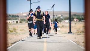 Lt. Col. Joseph Bincarousky, 412th Security Forces Squadron commander, completes the Annual Police Week Run/Ruck/Walk Event at Edwards Air Force Base, California, May 10. (Air Force photo by Giancarlo Casem)