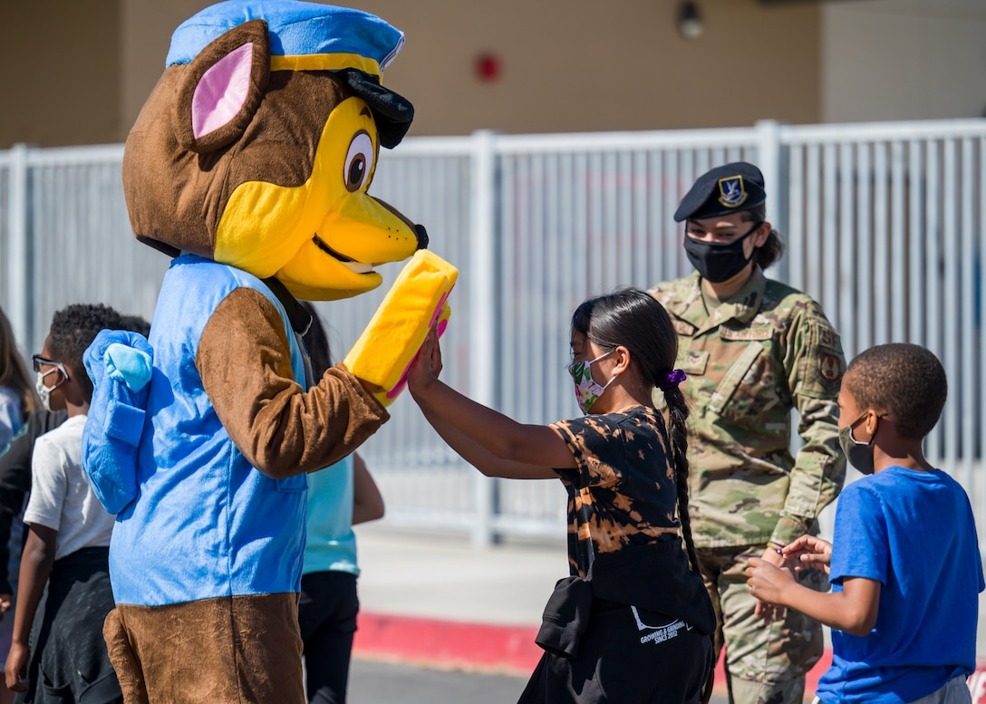 Students at Bailey Elementary School on Edwards Air Force Base, California, received a special visit from the 412th Security Forces Squadron and their special guest during Police Week 2021, May 11. (Air Force photo by Giancarlo Casem)