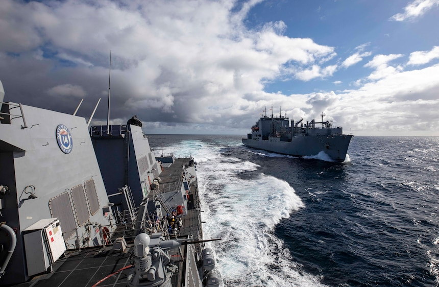 The Arleigh Burke-class guided-missile destroyer USS Paul Ignatius (DDG 117) pulls away from the Military Sealift Command dry cargo and ammunition ship USNS William McLean (T-AKE 12) after a replenishment-at-sea evolution.