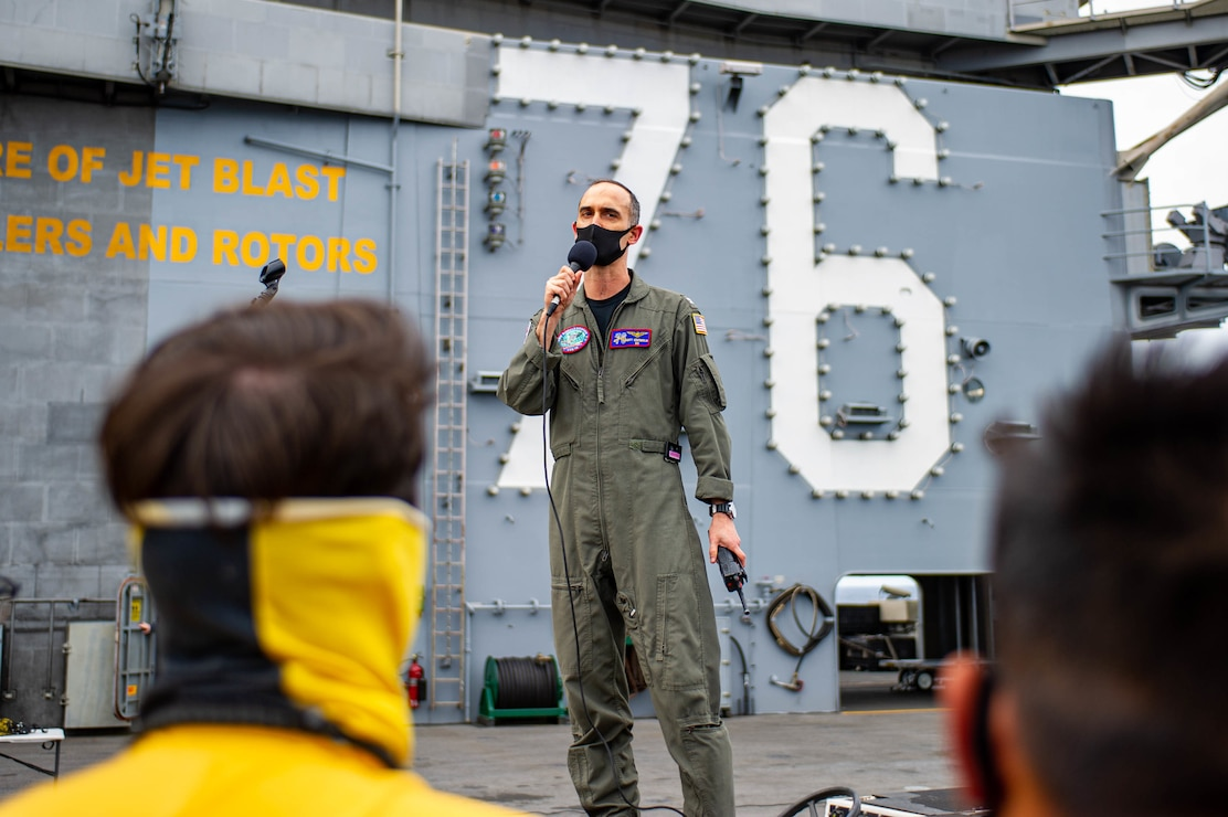 Capt. Matthew Ventimiglia, executive officer of the U.S. Navy's only forward-deployed aircraft carrier USS Ronald Reagan (CVN 76), speaks during an all-hands call on the flight deck.
